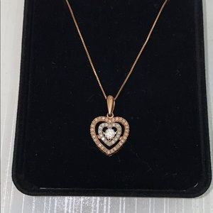 Heart necklace with a diamond
